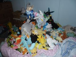 Pile of Pokemon Plushies... and a cat? by SuperSonicFireDragon