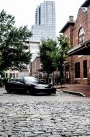 car on cobble stones by drifter542