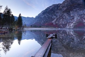 Glossy water at Bohinj lake. by eriksimonic