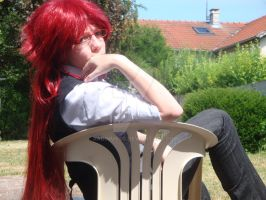 a cosplay of grell sutcliff by RadimusSG