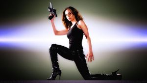 Eliza Dushku Leather and a Gun by Dave-Daring