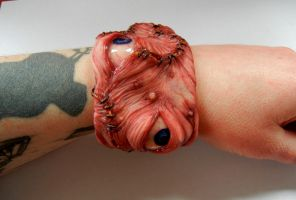 Stitched eyes cuff side by dogzillalives