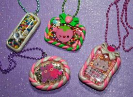 Resin and Polymer Clay Cutie Necklaces by squeekaboo