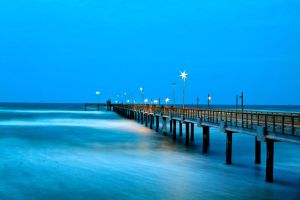 Fishing Pier at Sunset by Bartonbo