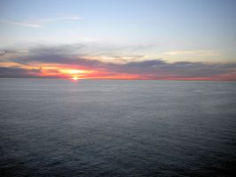 Sunset at sea by crudinski