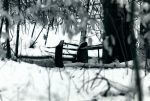 Chair by the creek in snow by cymrueira