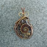 Loyal Conseil Ammonite Fossil Pendant by magpie-poet