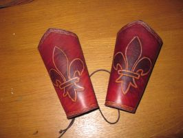 Commissionned lys bracers by akinra-workshop