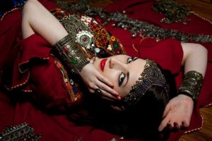 Afghan Woman - surrounded by jewels by Apsara-Stock