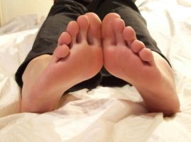 My soles on the bed by KarinaDreamer