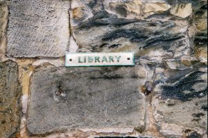 Library Sign on Stone Wall by Fea-Fanuilos-Stock