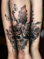 Skull with guitar by tikos