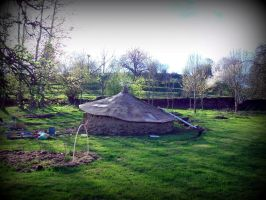 celtic roundhouse with clay in the garden... by gangahimalaya