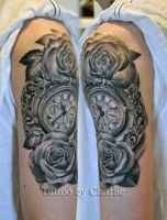 pocket watch tattoo with roses healed by gettattoo