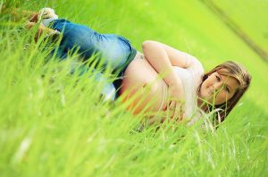 laying in green by Burder