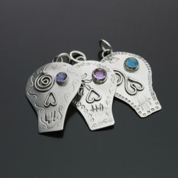 Jewel eyed Skull Pendants by kimistry3