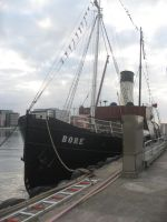 Boat at Anchor by sea side Harbor Channel in Malmo by MushroomBrain