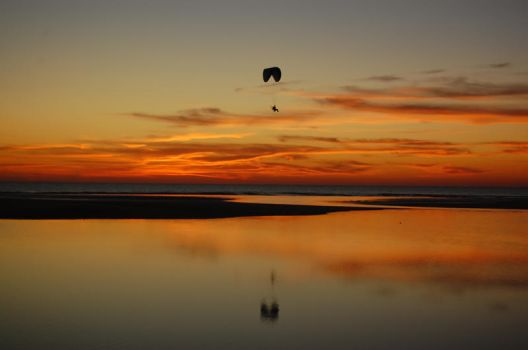 Paragliding at dawn by 001011011