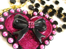 Heart Bow necklace by pinkminx