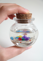 Miniature Coral Reef in a Bottle. by oceansinminiature