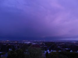 Storm sunset over the city by Kayleigh-Kaz