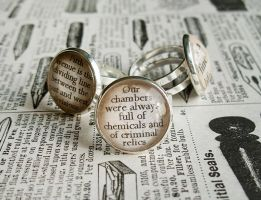 Glass Cabochon Text Rings by ldhenson
