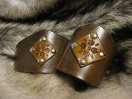 Brown Leaf Cuffs by TheScreamingNorth