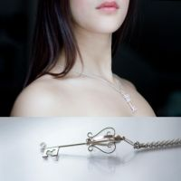 Spinning Silver Key Pendant by MirielDesign