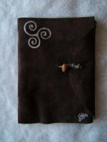 Simple leather-bound songbook by Adreanna