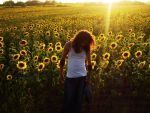 Man before the sunflowers 2 by Cautionline