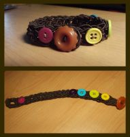 Crocheted bracelet with rainbow buttons. by Amigurumi-Lover