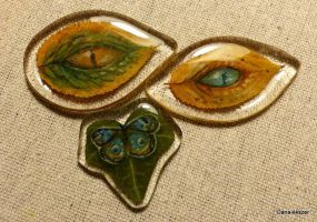 Dragon eyes and butterfly on leaves by artoftas