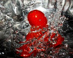 High Speed - Tomatoes dropped into water - detail by RinFlorin