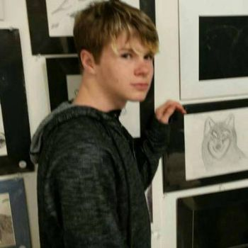 Me at art show with artwork by TheOmegaWolfster