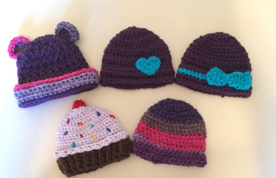 Purple newborn hats by asexualgoddess