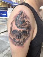 Skull with butterfly by Roger Axelsson by DublinInk