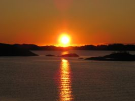 tropical sunset in Norway by Charon1