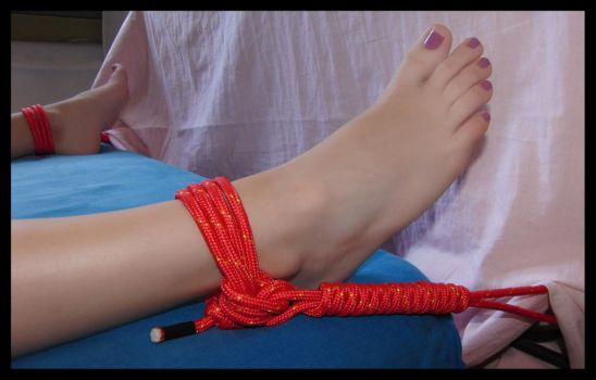 Tied up to bed by RopeFun
