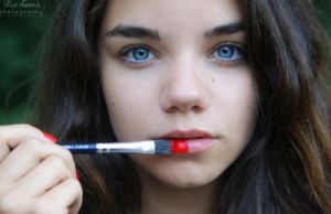 red paint and blue eyes by Juelej