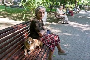 Old lady with old dog by marius1956