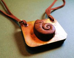 Wooden Ammonite with Brass by salvagedsword