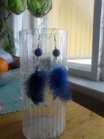 Feather earrings by Carmabal