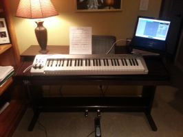 A keyboard on top of a piano by fencergirl00