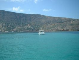 Boat in Spinalonga bay by kenseoul