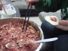 Making dumplings for Chinese New Year by Laura-in-china