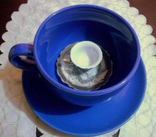 Tea cup in tea cup again by Maleiva