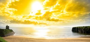 panorama of a Beautiful yellow sun over the Ballyb by morrbyte