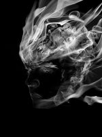face in smoke by At0micDrag0n