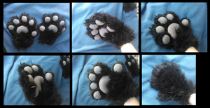 Plushy Wolf Paws by CuriousCreatures
