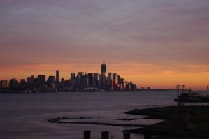 Sunset over lower Manhattan NYC by HMoreng